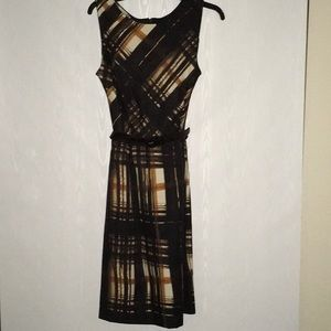 Dress with belt and small slit in back.